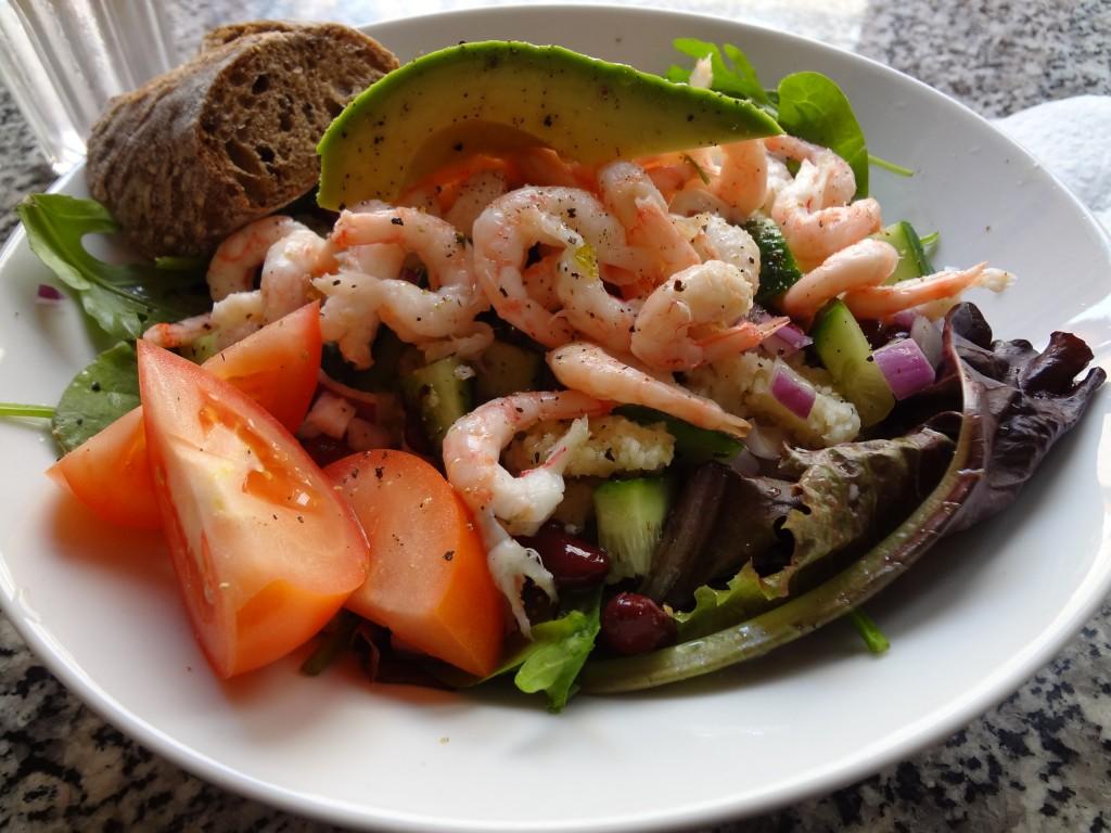 Beautiful salad of avocado, shrimp and vibrant greens