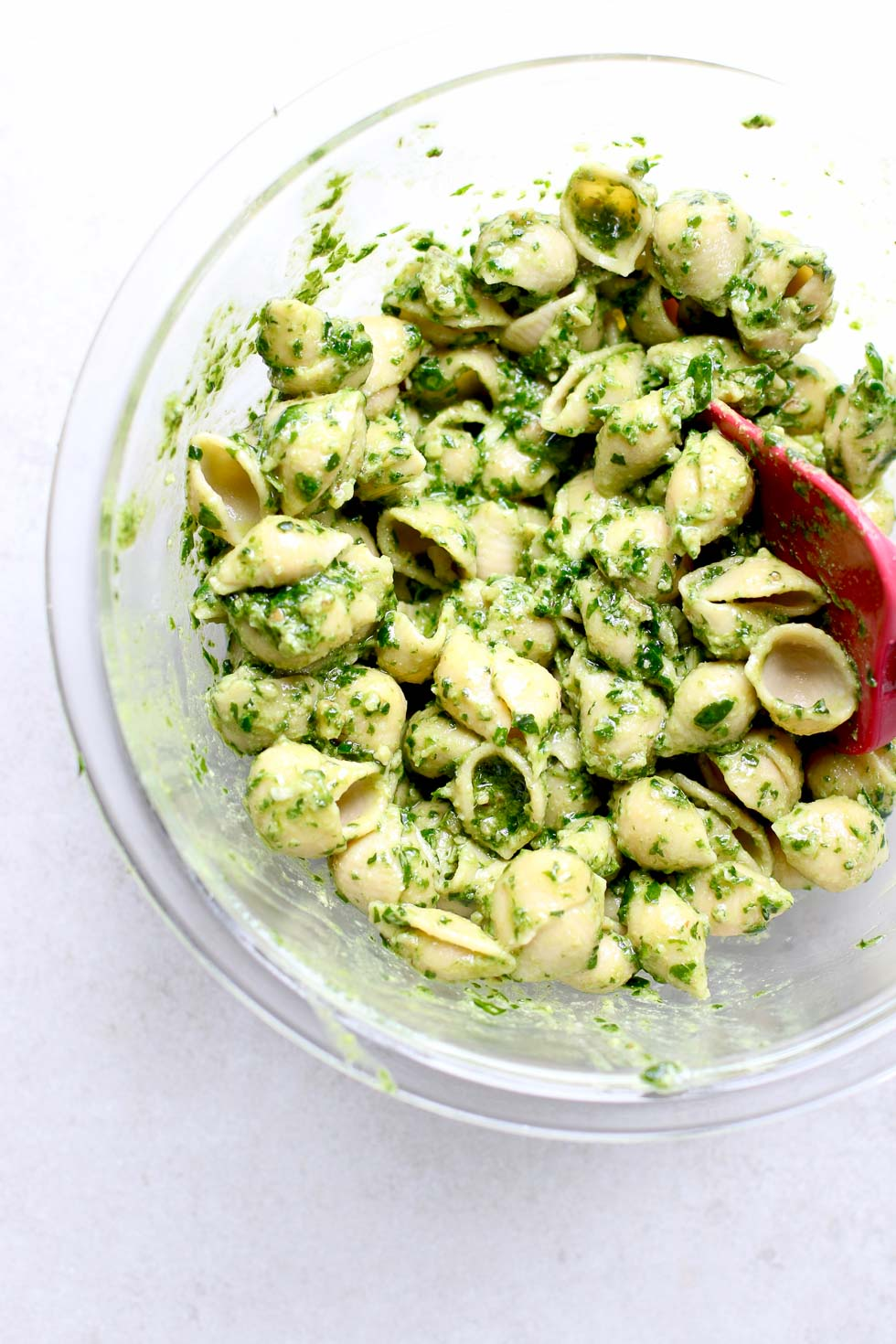 Mixing Chickpea Pasta with Walnut Pesto
