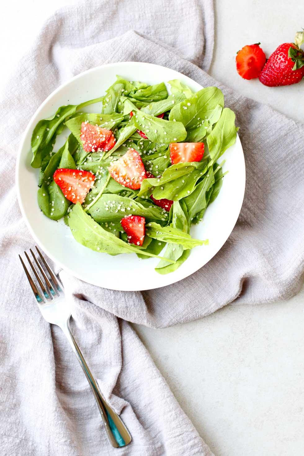 Strawberry Arugula Salad with Hemp Seed with fork