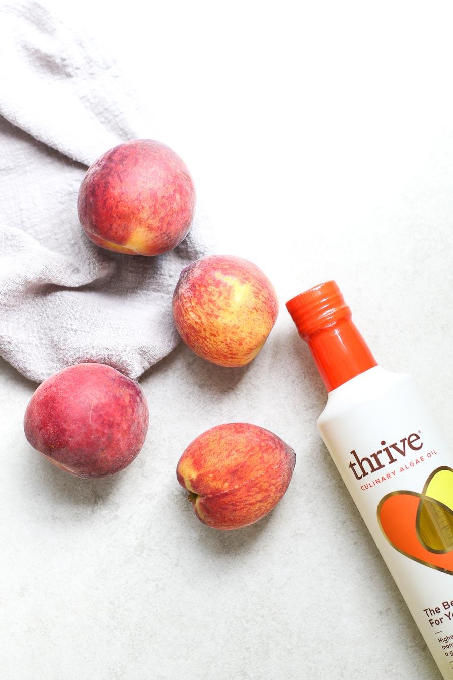 Peaches with Bottle Thrive Algae Oil