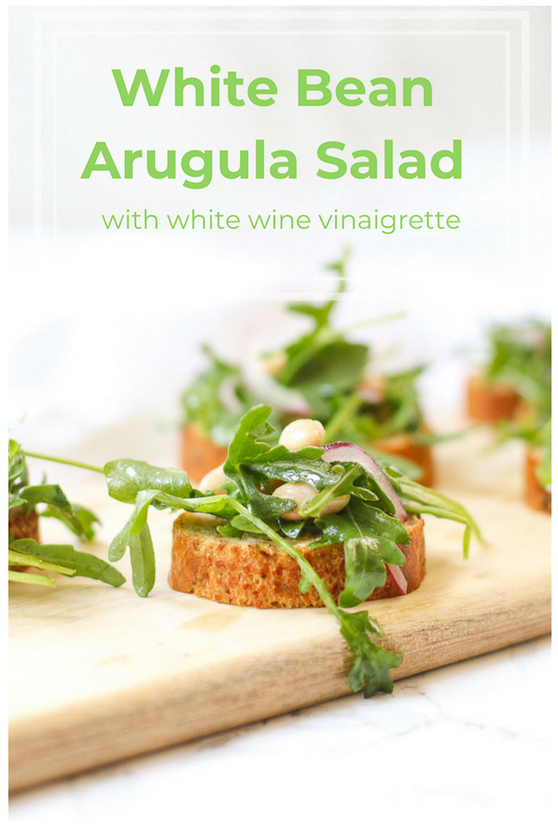 This easy White Bean Arugula Salad Crostini is an easy no-cook meal that's perfect for a light lunch or snack dinner crostini! The homemade white wine vinaigrette brings it all together. #crostini #snackdinner #saladtoast #arugula #cannellinibeans #homemadevinaigrette #marisamoorenutrition
