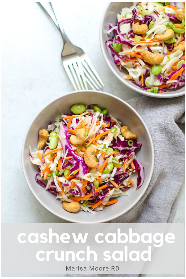 This Crunchy Cashew Cabbage Salad with toasted sesame dressing is an easy weeknight meal that's ready in 10 minutes. With edamame for protein, it's a vegan salad that's a little sweet and a lot crunchy! #saladrecipes #edamame #cashews