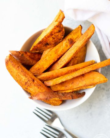 baked sweet potatoes in a bowl overhead