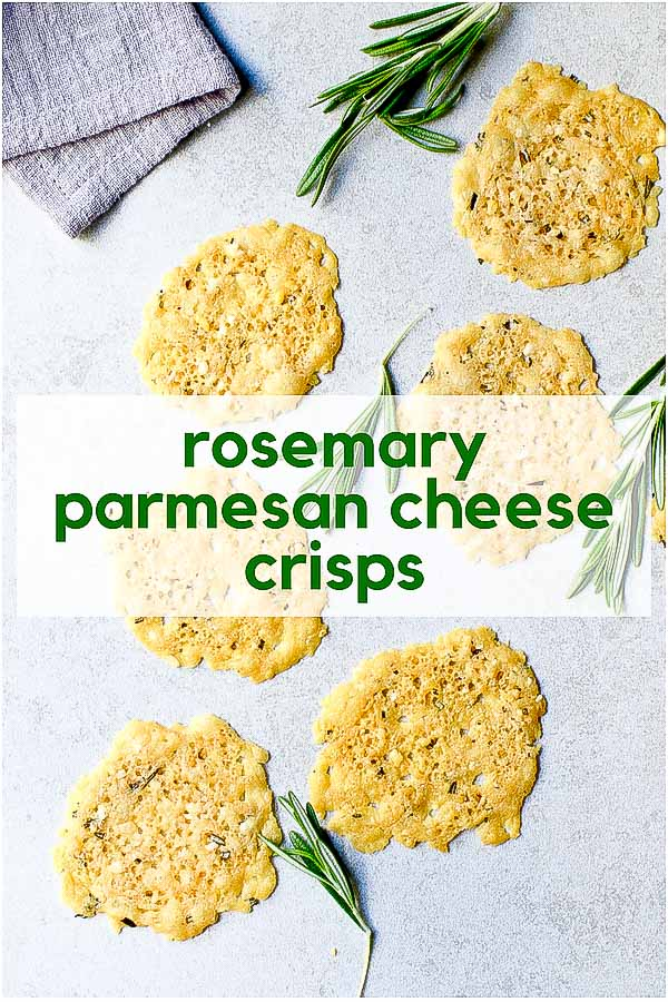 Rosemary Parmesan Cheese Crisps with fresh rosemary sprigs on gray background