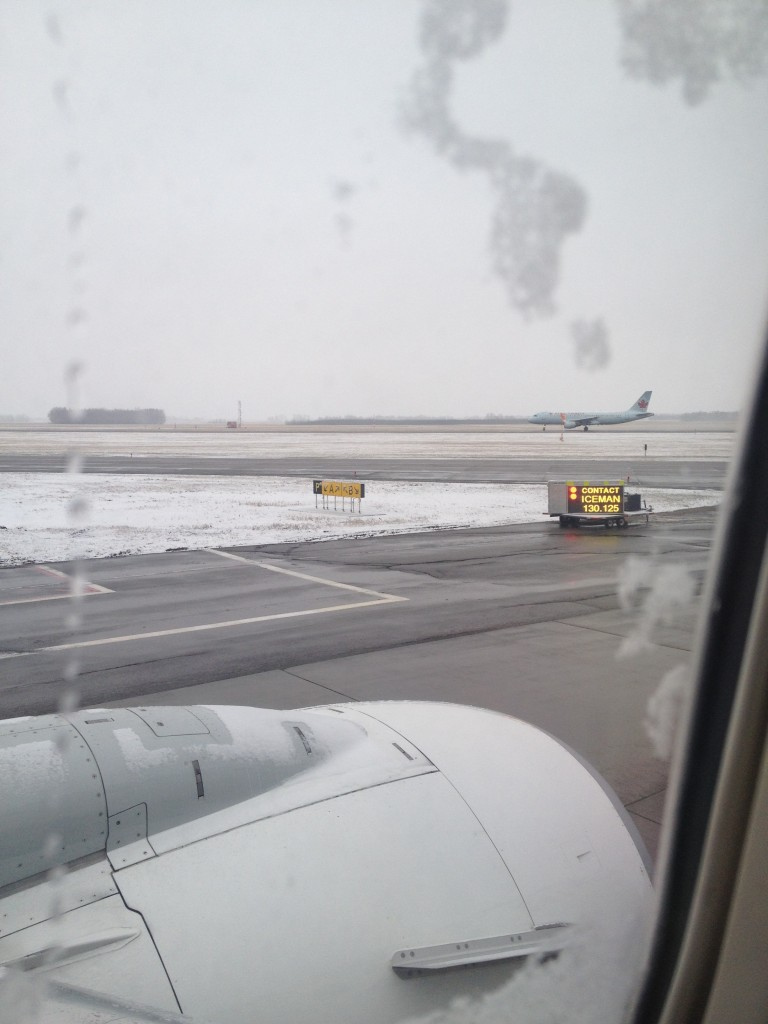 Snow in Edmonton - Plane Being De-iced