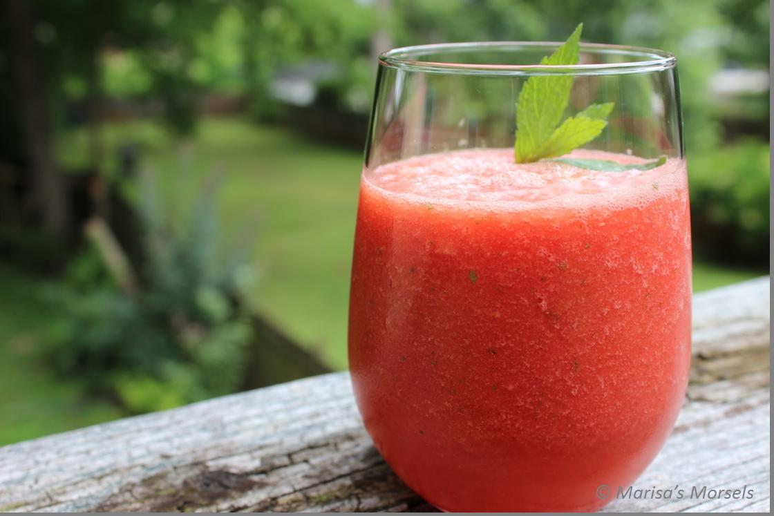 Watermelon mint slushy in a glass on a ledge