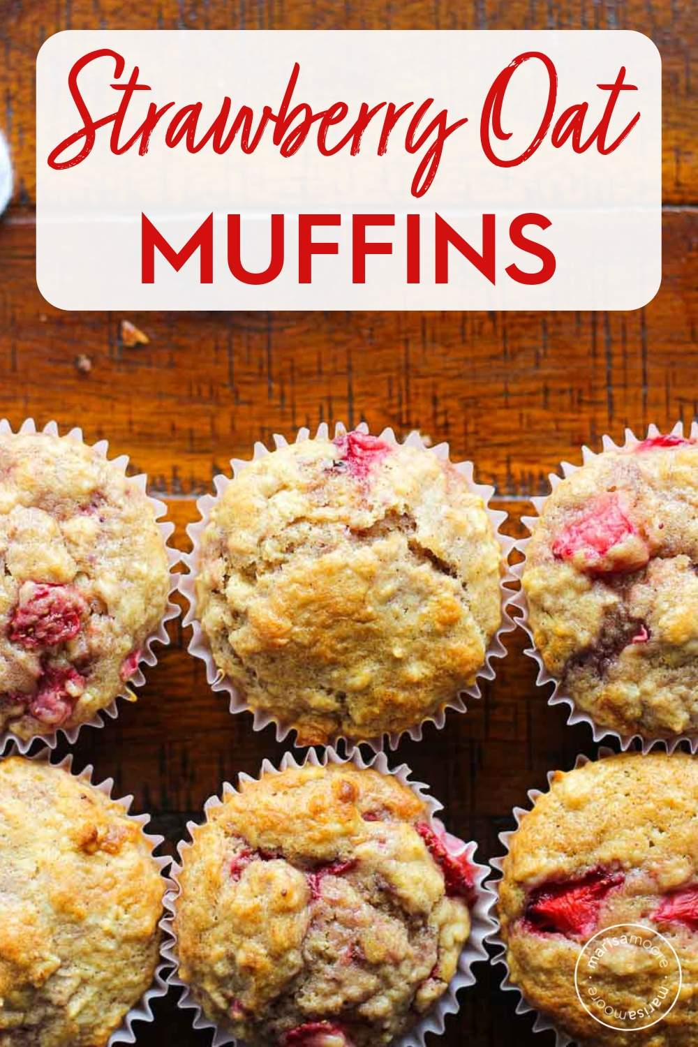 Strawberry muffins on a brown table