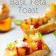 Peach basil feta toast with basil garnish