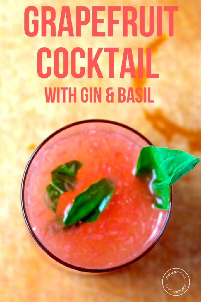 cocktail in a glass with basil