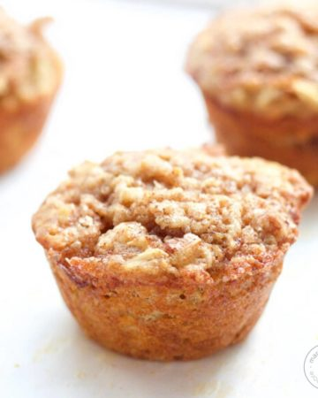 apple cinnamon muffins on white background