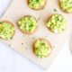 Egg Avocado Salad on Sprouted Seed Crackers overhead vertical