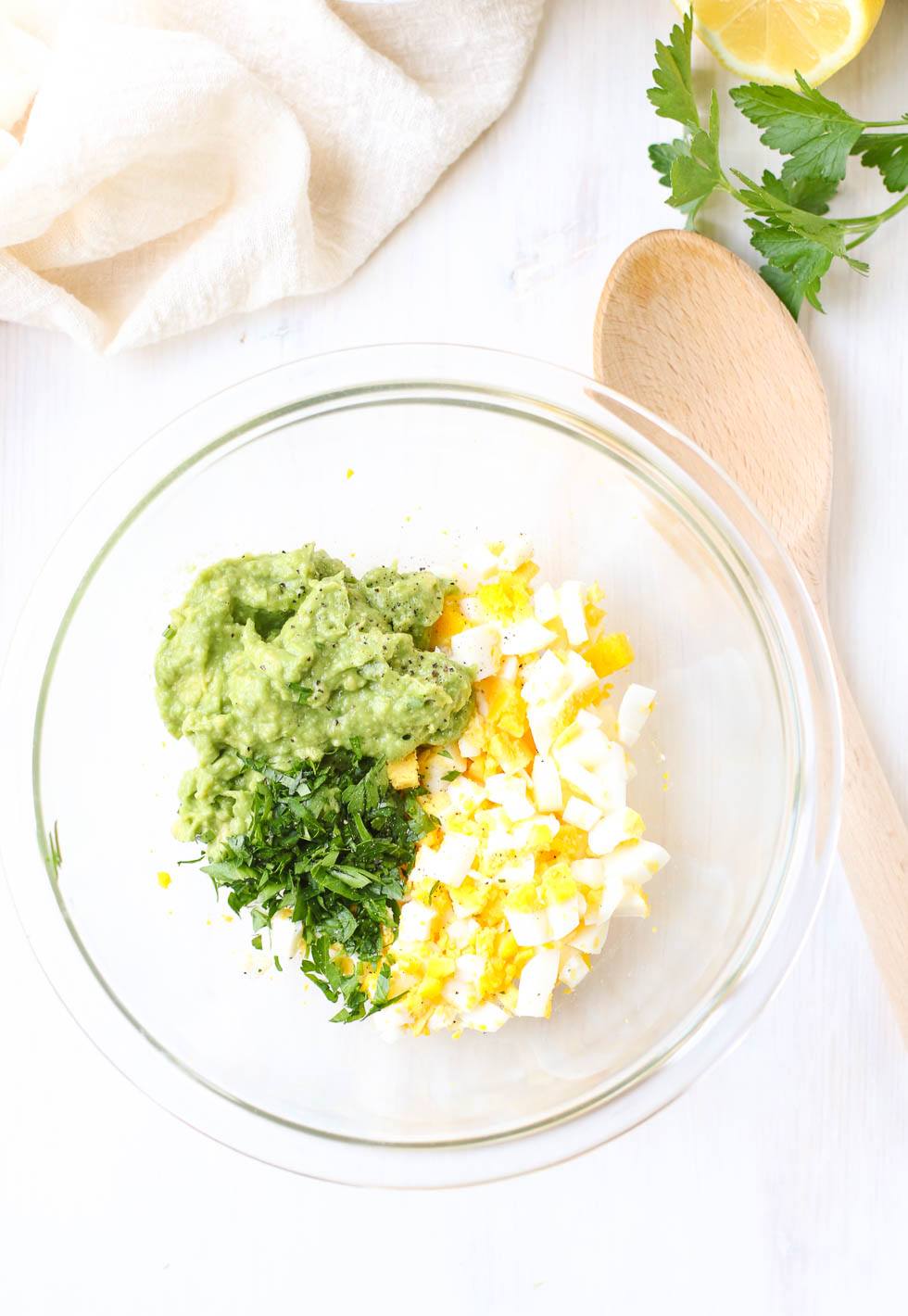 Egg avocado Salad Mixing Ingredients in a bowl
