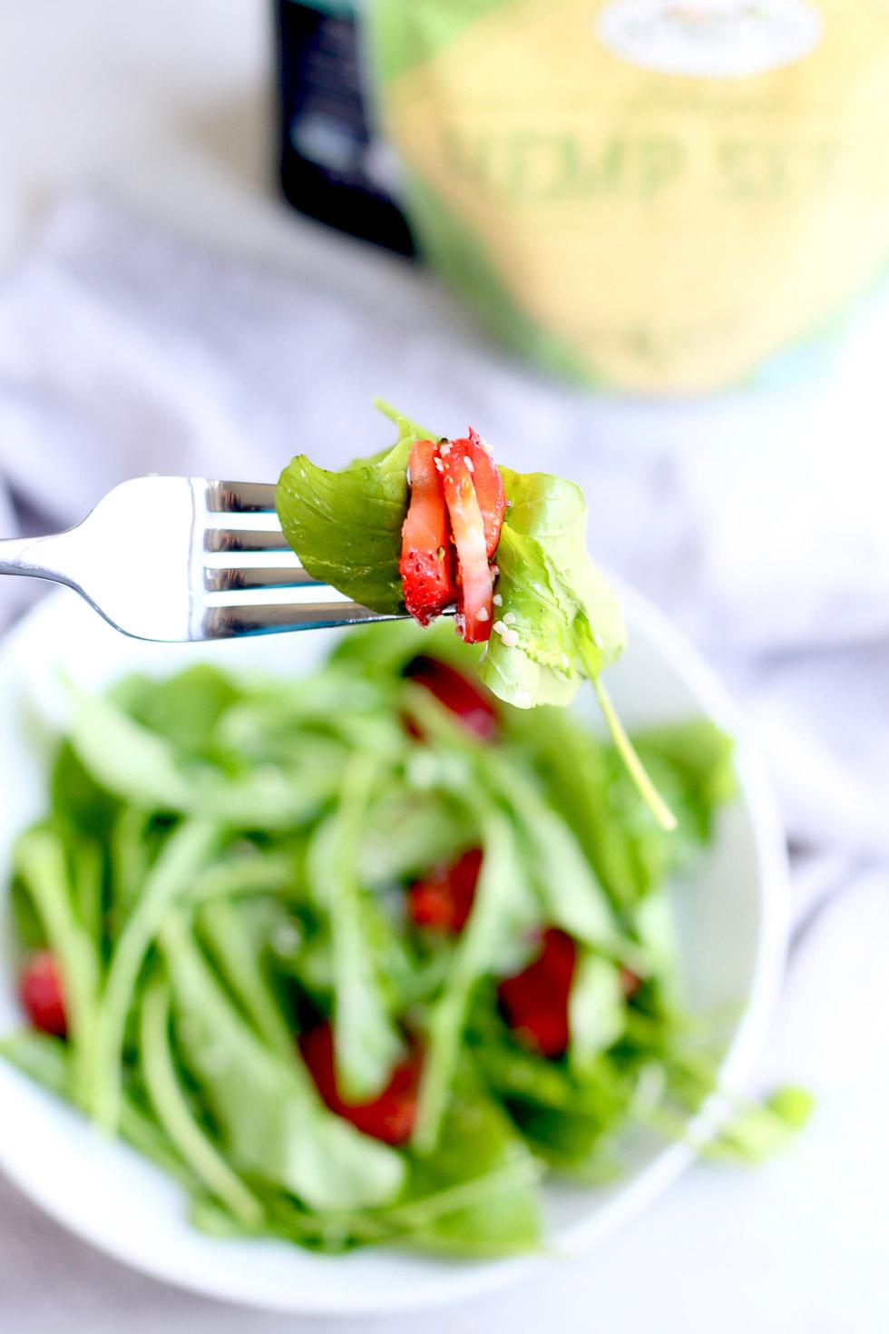 Strawberry Arugula Salad with Hemp Seeds on Fork