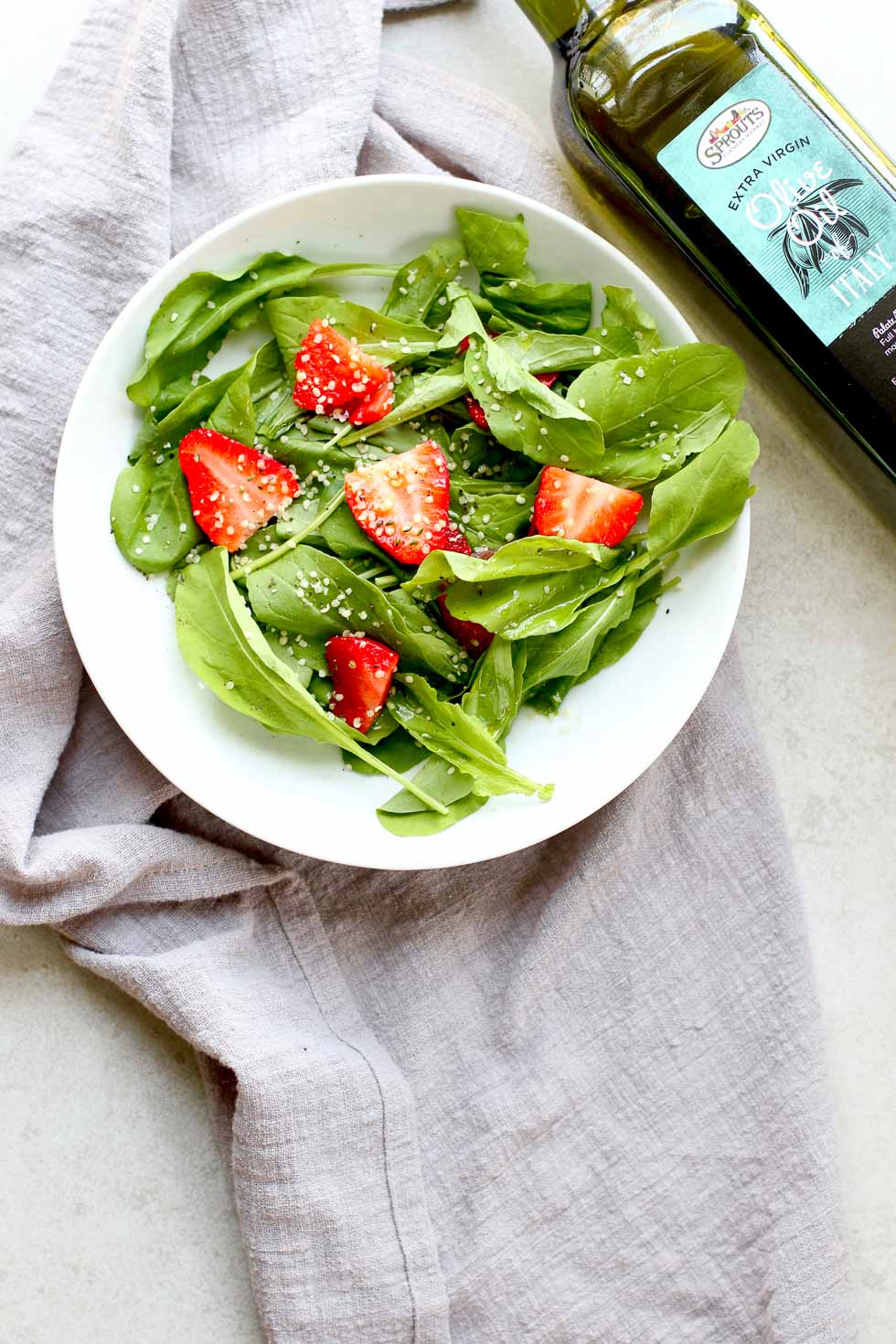 trawberry Arugula Salad with Hemp Seed Hero with Bottle Extra Virgin Olive Oil