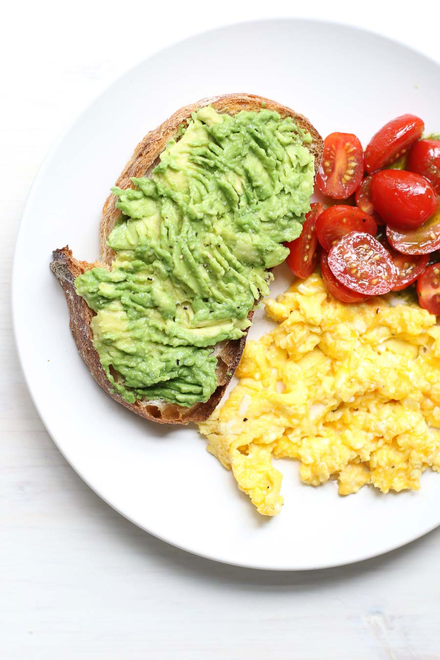 avocado toast with eggs and grape tomatoes with Basil Vinaigrette