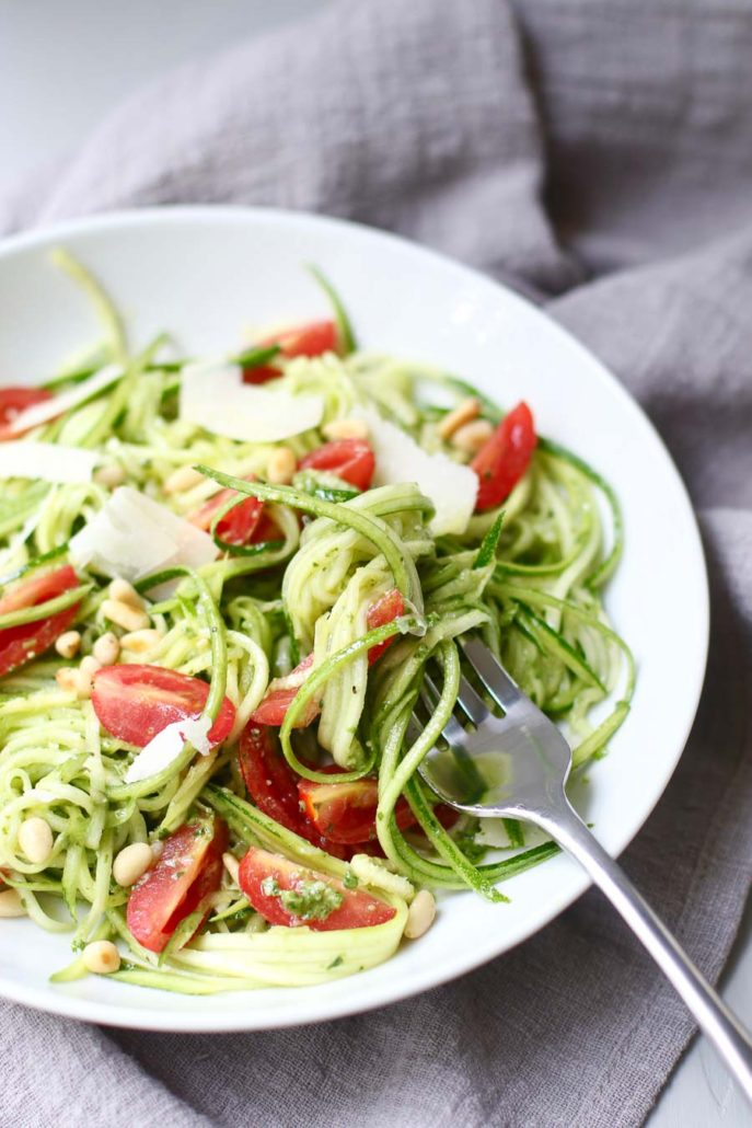 Pesto Zucchini Noodle Salad with a fork twirl