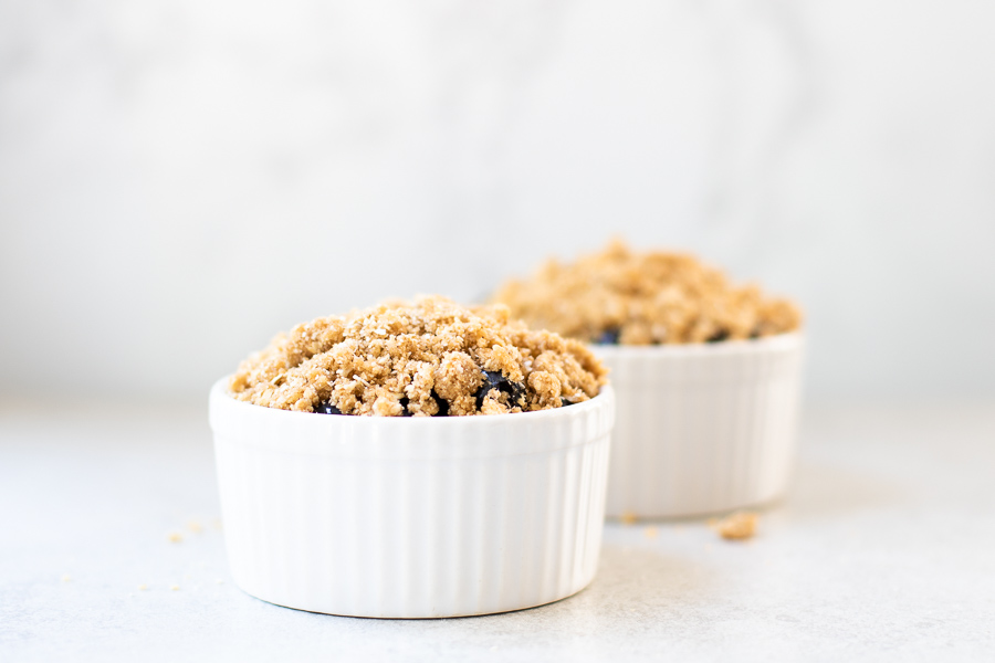 Oat Walnut Topping on blueberries in ramekins - healthy blueberry crisp
