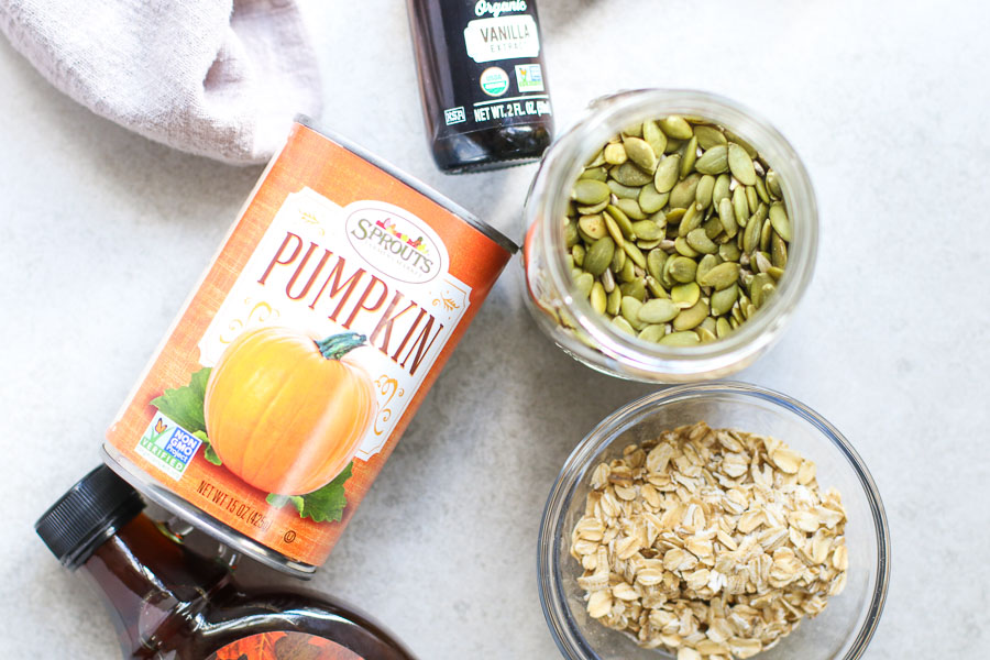 Ingredients for pumpkin spice granola - oats pumpkin seeds canned pumpkin maple syrup