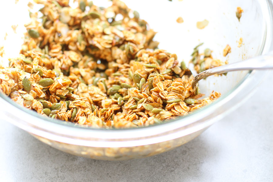 Pumpkin spice granola in a bowl with a spoon