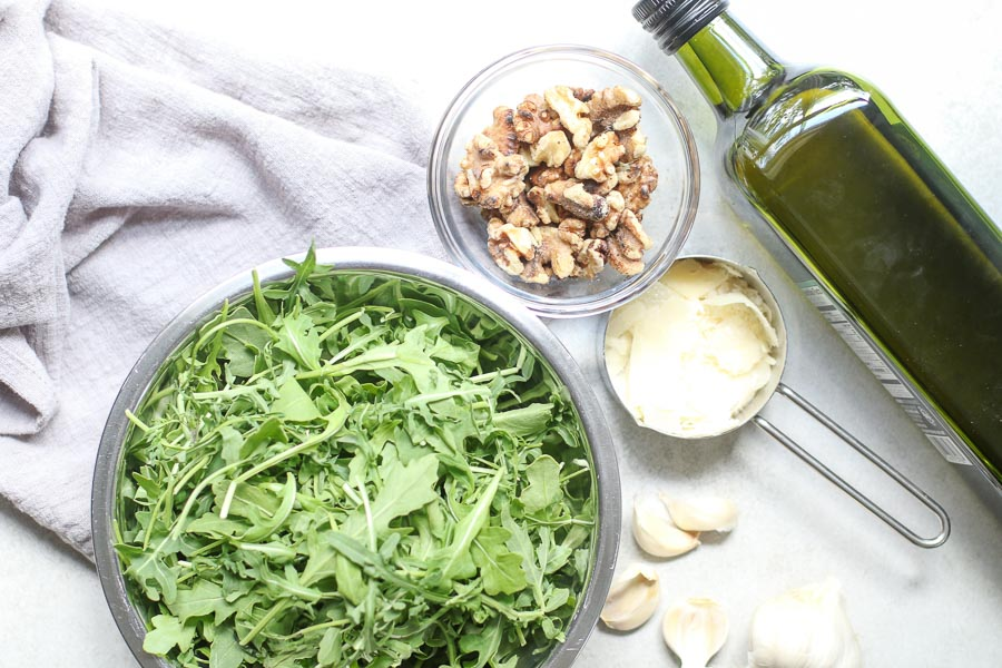 arugula walnut pesto ingredients from overhead
