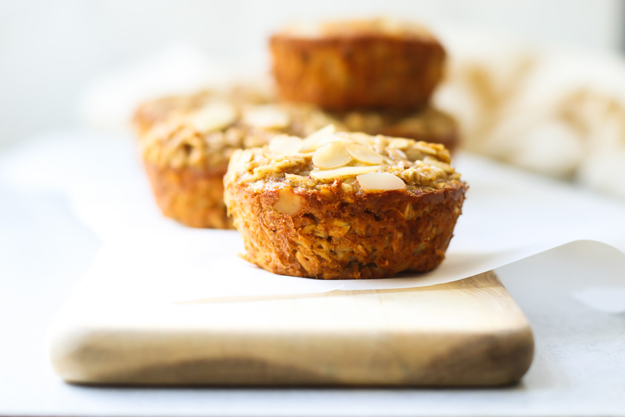 Almond Butter Baked Oatmeal Cups on a wood board