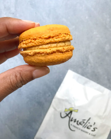 Amelie's Bakery Macaron in hand