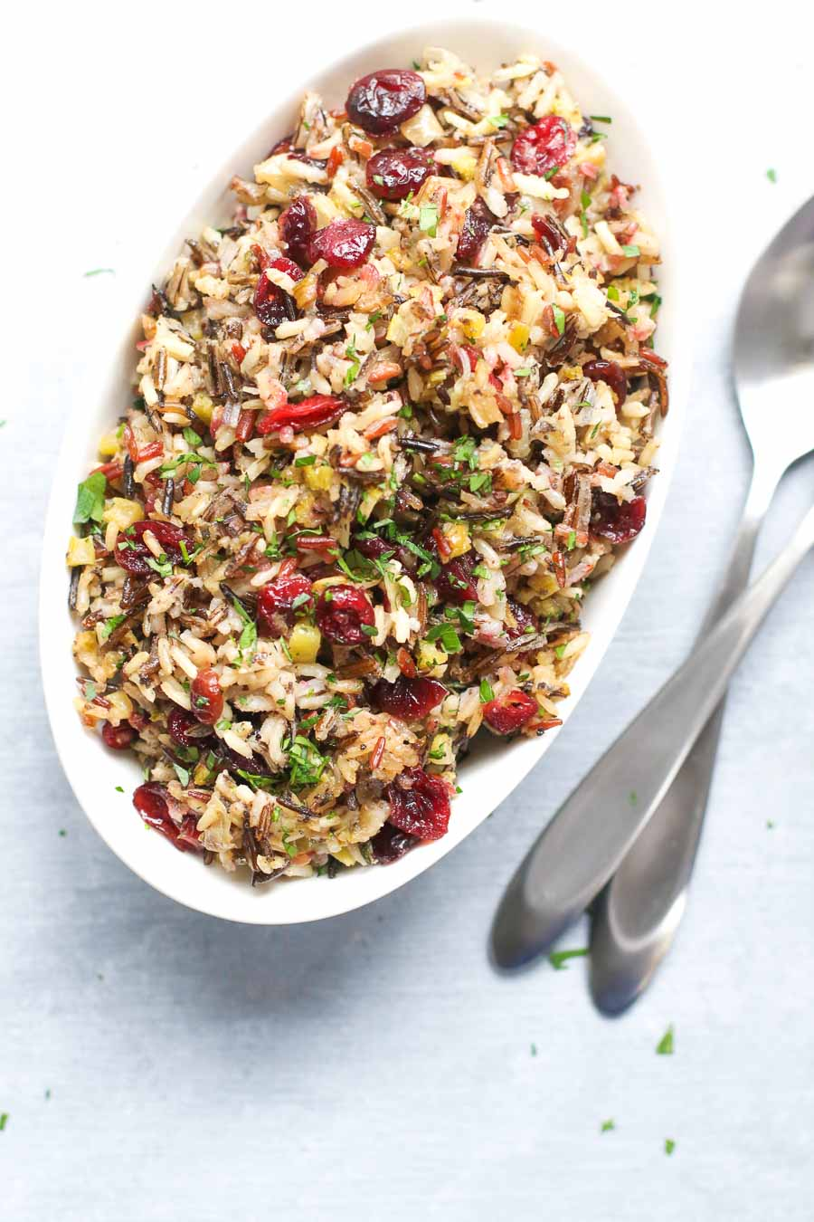 vegan wild rice stuffing in a bowl with utensils