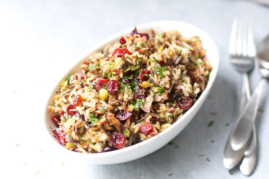 vegan wild rice stuffing in dish with utensils