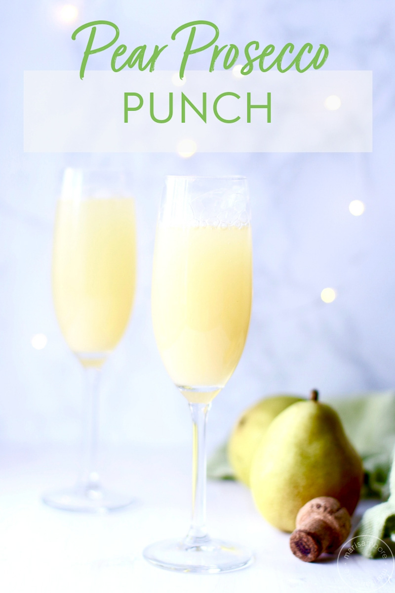 With only three ingredients, this sparkling Pear Prosecco punch is a healthy cocktail recipe. It's like a pear mimosa or Bellini, so try it for brunch or a holiday party! #cocktailrecipes #pears