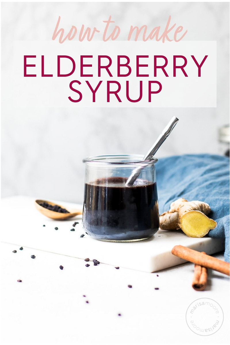 ginger elderberry syrup in a jar with ginger and cinnamon