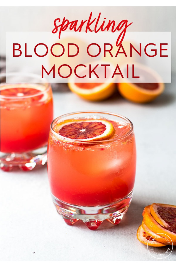 sparkling blood orange mocktail in two glasses PIN