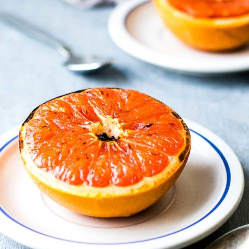 Broiled Grapefruit on two plates