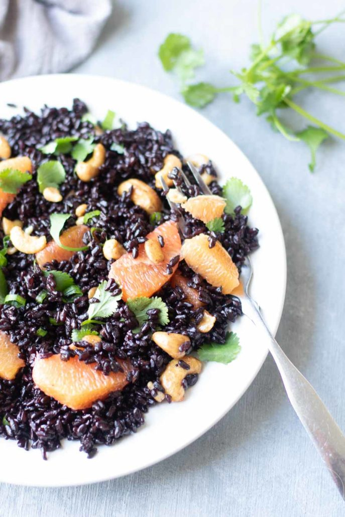 orange and black rice salad on a plate