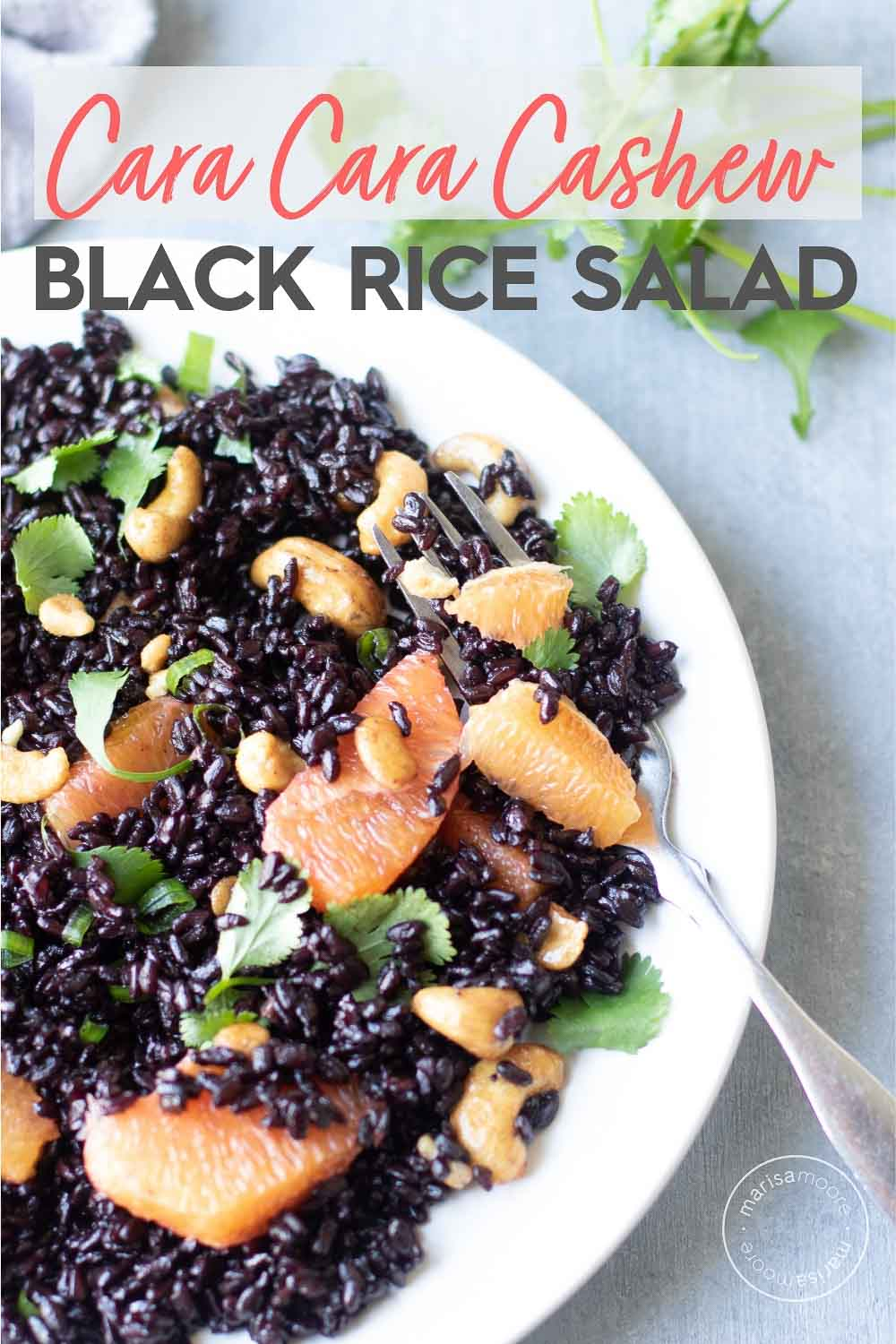 cara cara oranges and cashew black rice salad on a plate