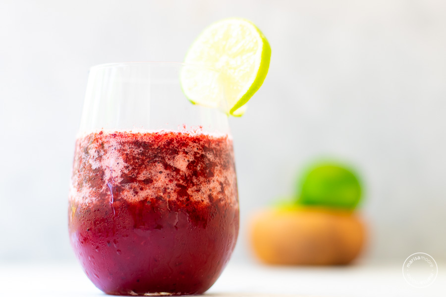 Cherry Lime Slush in a glass with slice of lime