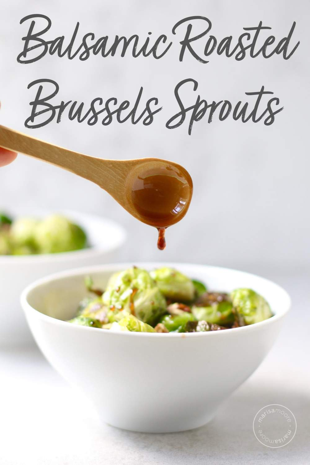 Roasted brussels sprouts in bowl with balsamic glaze on a spoon