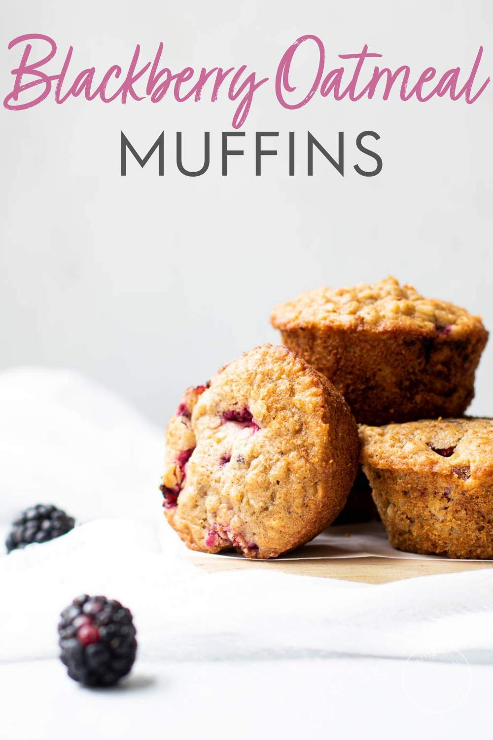 Blackberry Buttermilk Muffins on a white backdrop