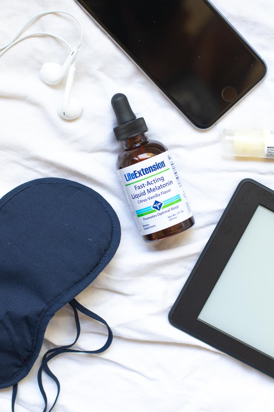 Bottle-of-Life-Extension-Melatonin-with-sleep-mask-and-ear-buds