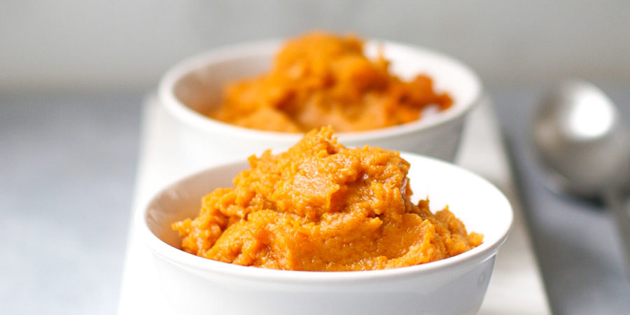 Baked Sweet Potato Pudding in two small white bowls