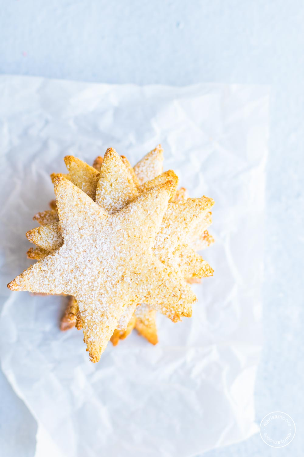 star cookies stacked on parchment