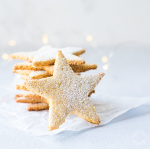 Almond Flour Cookies stacked with lights in the background
