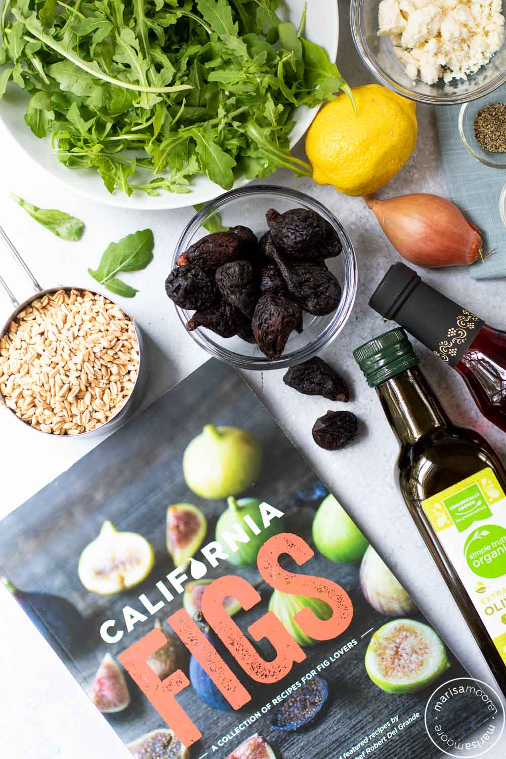 Ingredients for fig farro salad with a California Fig Cookbook