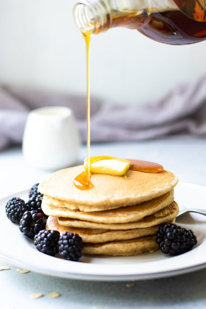 Oat Flour Pancakes with Syrup pouring