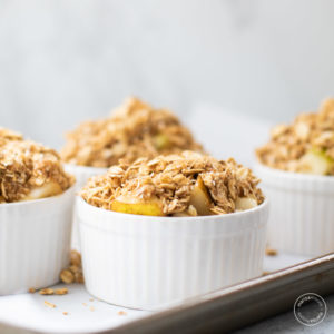 Pear crumble on a baking pan before cooking