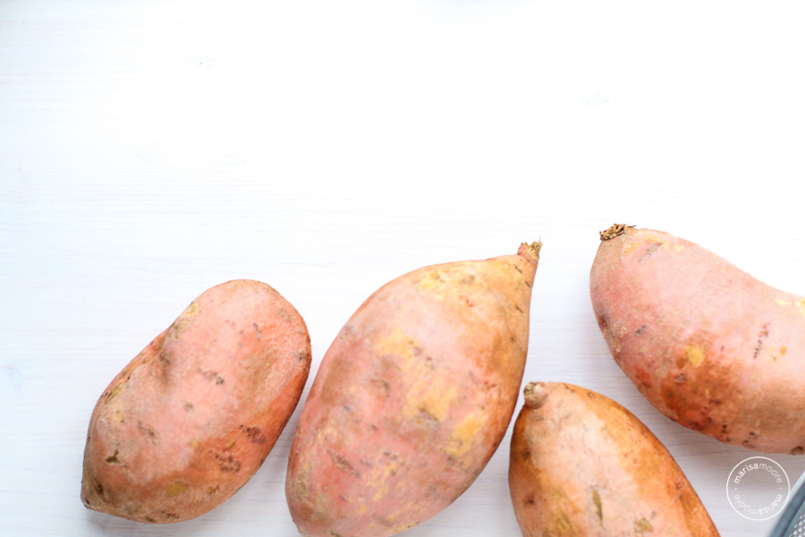 Whole sweet potatoes on a white background