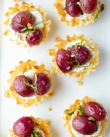 Grape Cheese Walnut Bites on a white plate