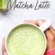 matcha latte in a mug with hands holding it