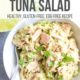 avocado lime tuna salad in white bowl with a fork