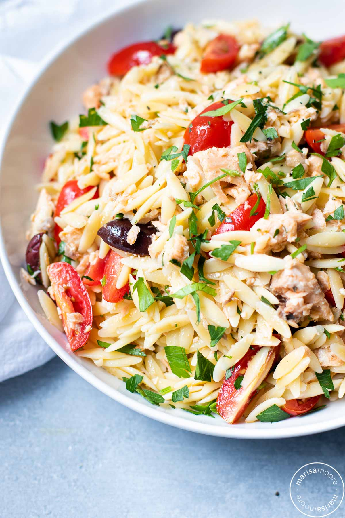 Orzo salad in a white bowl