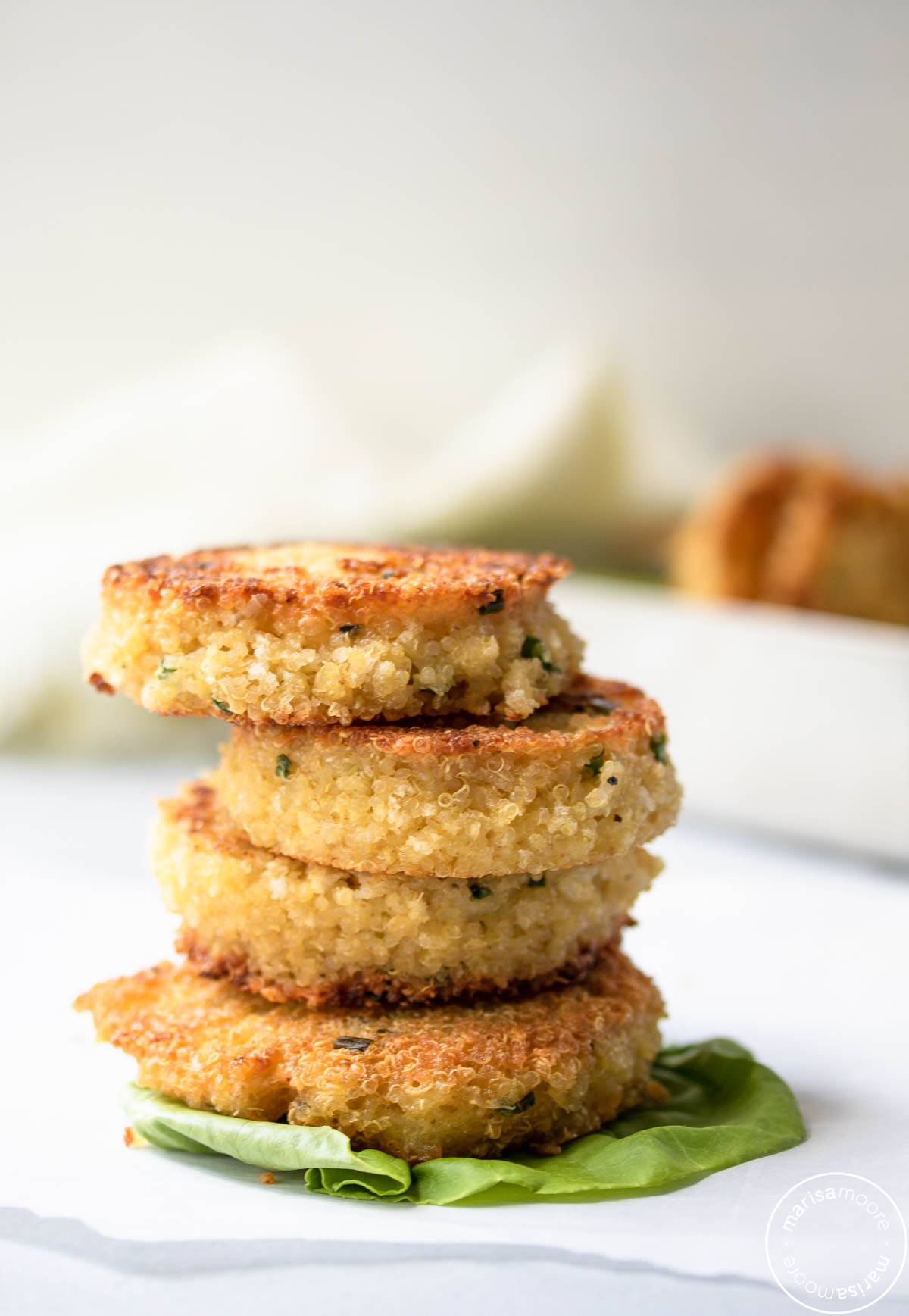 4 crispy quinoa patties stacked